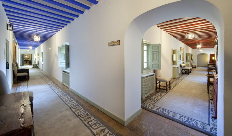 Parador de Almagro interior, hallway, traditional architecture in bright colours, marble floors