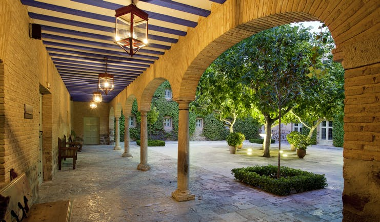 Parador de Almagro terrace and courtyard garden, traditional architecture, trees