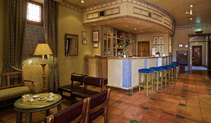 Parador de Avila Heart of Spain bar indoor seating area bar traditional décor tiles