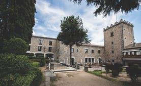 Parador de Avila Heart of Spain hotel exterior stone building pathway trees shrubbery