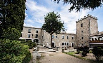Parador de Avila Heart of Spain hotel exterior stone building pathway trees shrubbery