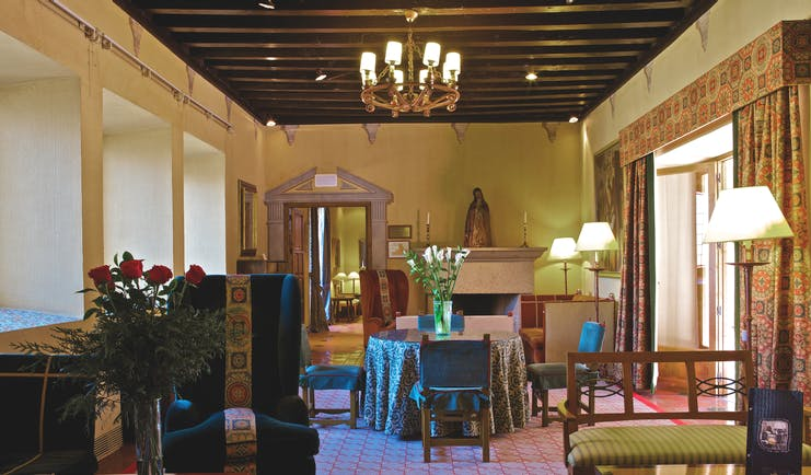 Parador de Avila Heart of Spain lounge indoor seating armchairs tables traditional décor