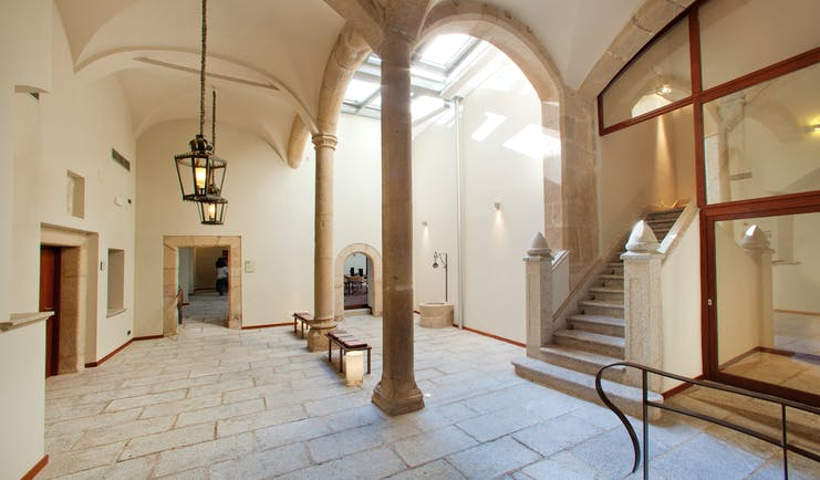 Interior of hotel with stone columns and archways