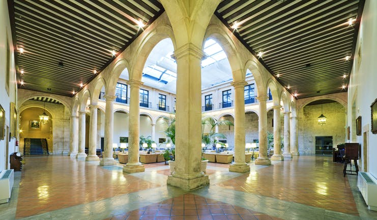 Parador de Lerma lobby, marble columns, traditional decor and architecture, indoor seating area