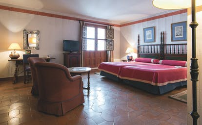 Parador de Merida Heart of Spain standard double bed room bed seating area traditional décor