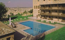 Parador de Toledo Heart of Spain pool hotel building view of city in background