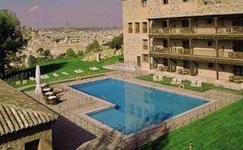 Parador de Toledo Heart of Spain pool hotel building view of city in background