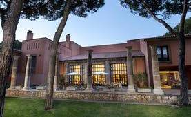 Parador de Tordesillas exterior, hotel building, traditional architecture, terrace, trees, lawn