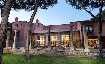 Parador de Tordesillas exterior, hotel building, traditional architecture, terrace, trees, lawn