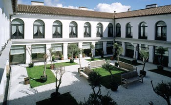 Parador de Trujillo Heart of Spain courtyard benches lawns trees