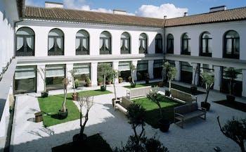 Parador de Trujillo Heart of Spain courtyard benches lawns trees