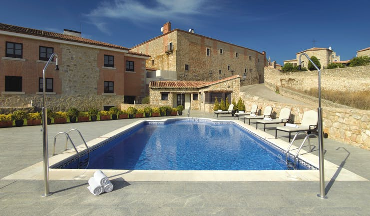 Parador de Trujillo Heart of Spain pool sun loungers hotel in background
