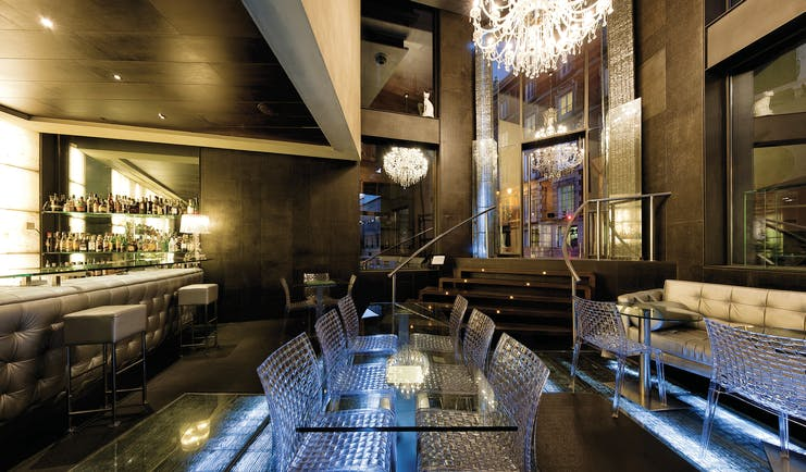 Hotel Urban Madrid glass bar glass tables and chairs chandelier bar stylish décor