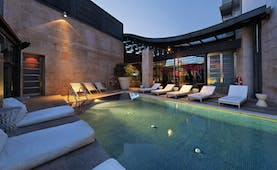 Hotel Urban Madrid pool outdoor sun loungers modern architecture