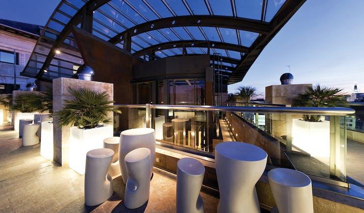 Hotel Urban Madrid rooftop abstract sculpture plants walkway