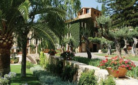 Belmond la Residencia Mallorca gardens hotel covered in foliage and gardens with palms and flowers