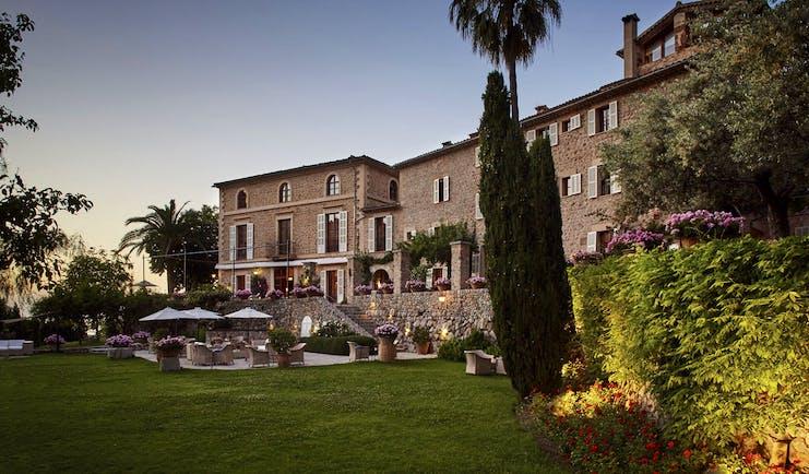 La Residencia Mallorca exterior stone building lawns outdoor dining terrace gardens