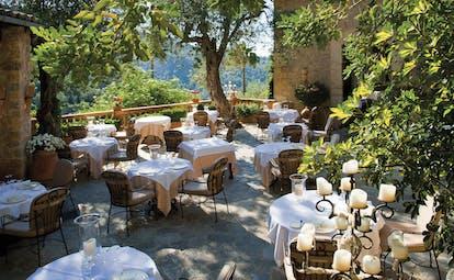 La Residencia Mallorca restaurant terrace dining area candelabras greenery trees