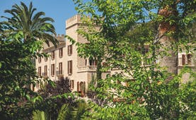 Castell Son Claret Mallorca exterior hotel building trees