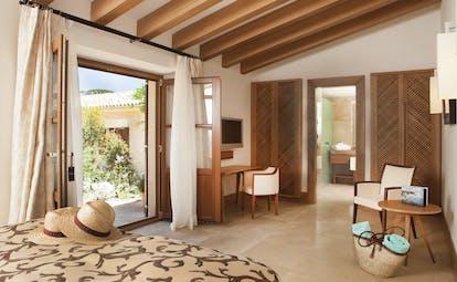 Castell Son Claret Mallorca garden suite bed en suite bathroom garden terrace modern décor
