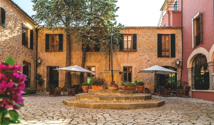 Gran Hotel Son Net Mallorca courtyard trees potted plants