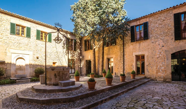 Gran Hotel Son Net Mallorca hotel exterior buildings courtyard trees potted plants