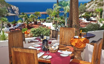 Hacienda Na Xamena Ibiza restaurant dining area terrace overlooking the sea