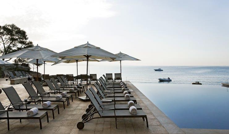 Hospes Maricel Mallorca poolside sun loungers infinity pool overlooking sea