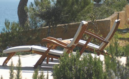 Can Simoneta Mallorca terrace sun loungers garden views sea in background