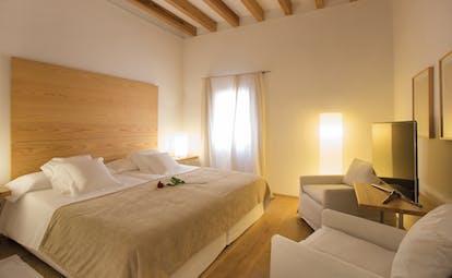 Convent de la Missio Mallorca double room armchairs bed modern décor