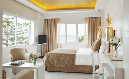 Hotel Illa d'Or Mallorca double plus bedroom bed armchairs modern stylish décor