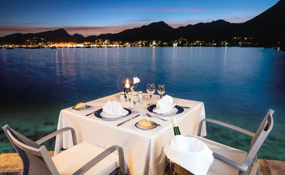 Hotel Illa d'Or Mallorca romantic dining table set for two night time overlooking the sea