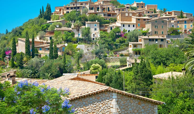 Hill-top village of Deia with its stone houses, olive trees and cypress trees in Mallorca