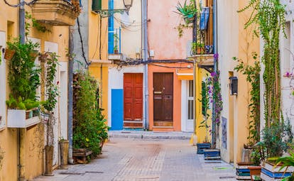 Colourful houses in alley with no cars and plants and balconies in Palma Mallorca