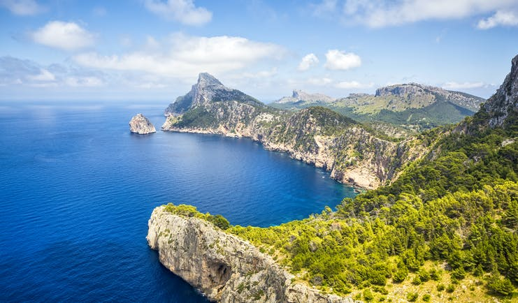 Rocky cliffs and headland overlooking blue sea at Cap Formentor in Mallorca