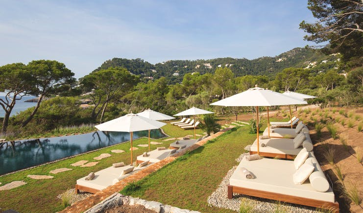 Pleta de Mar Mallorca infinity poolside sun loungers umbrellas overlooking sea