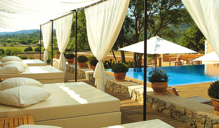 Son Brull Mallorca pool canopied sun loungers countryside views