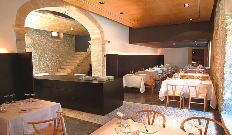 Son Brull Mallorca restaurant indoor dining area stone walls modern décor