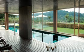 Son Brull Mallorca spa pool indoor pool large windows countryside views