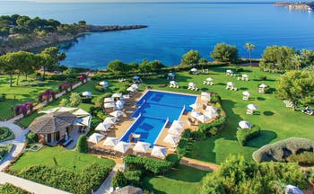 Aerial view of hotel showing swimming pool with close proximity to sea