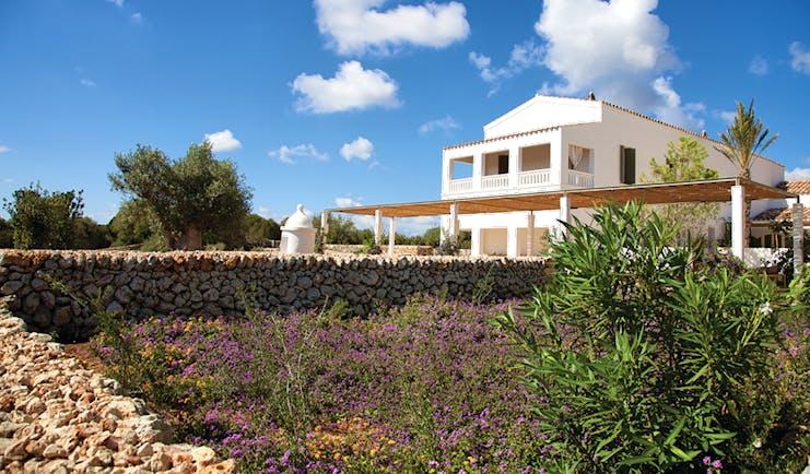 Torralbenc Menorca exterior hotel building flowers trees