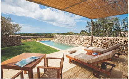 Torralbenc Menorca pool cottage terrace pool sun loungers lawn sea in background
