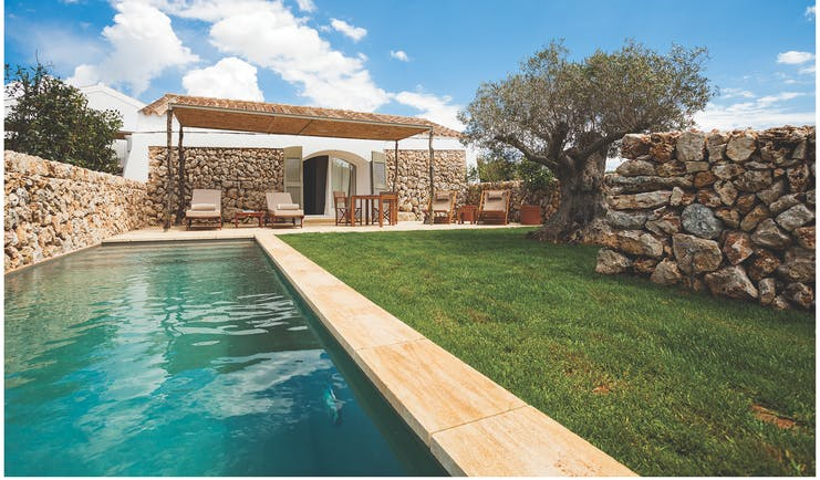 Torralbenc Menorca pool cottage private pool and garden terrace sun loungers lawn trees