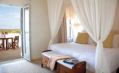 Torralbenc Menorca sea view room terrace canopied bed modern décor