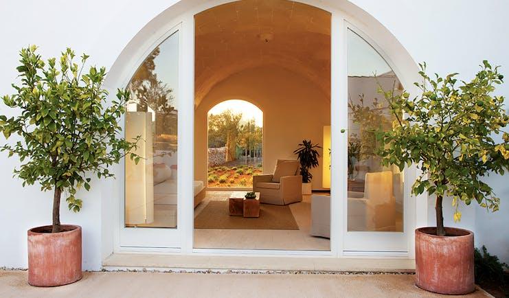 Torralbenc Menorca suite entrance garden views armchairs