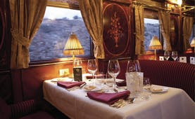 Dining table laid for meal in train carriage