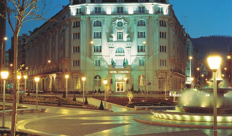 Hotel Carlton Bilbao exterior lit up at night view from street