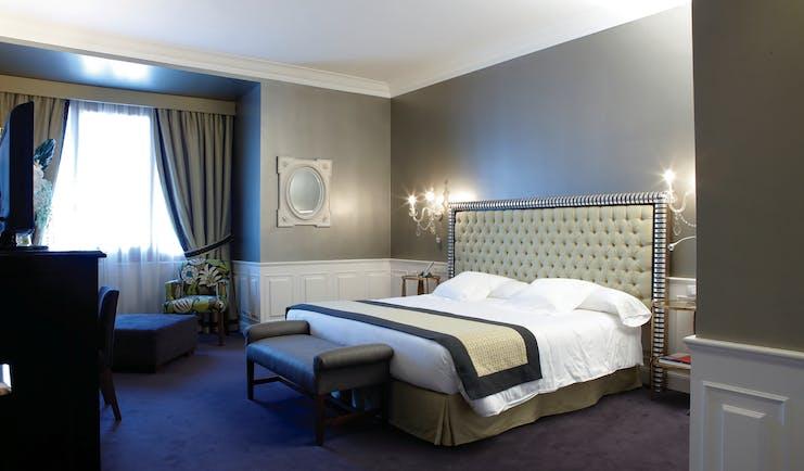 Hotel Carlton Bilbao junior suite bedroom bed ornate décor
