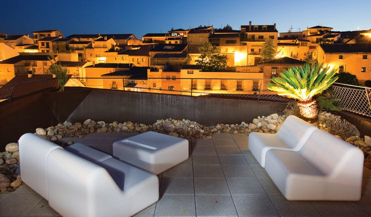 Hotel Viura Basque rooftop terrace at night outdoor seating area overlooking the city