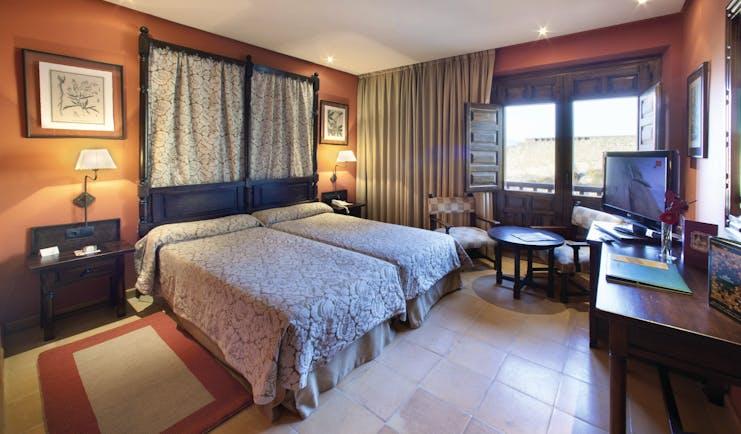 Parador de Sos del Rey Catalico Basque guestroom bed seating traditional Castilian décor